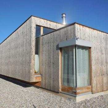 Maison neuve individuelle plain pied structure bois, bardage en bois vertical