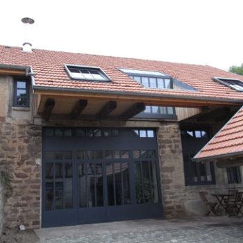 Rénovation d'une ancienne grange en bois en habitation