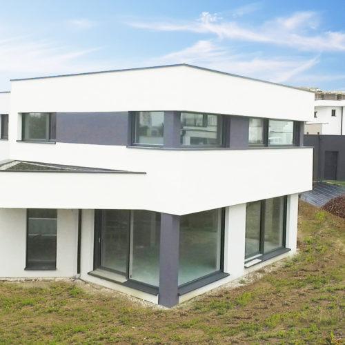 Maison passive ossature bois, revêtement crépi