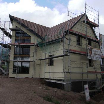 Levage d'une maison ossature bois, revêtement façade crépis