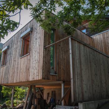 Maison à ossature bois et charpente en bois, bardage bois