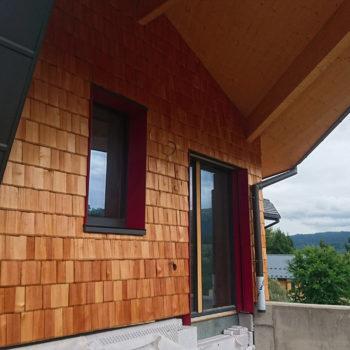 Maison individuelle ossature bois, façade sud, bardage en bois