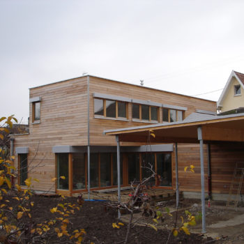 Maison individuelle cubique ossature bois, bardage en bois horizontal