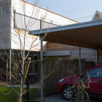 Maison individuelle cubique ossature bois, charpente bois, carport bois, bardage bois