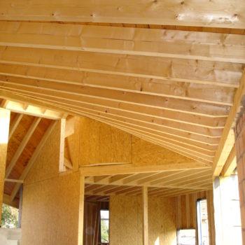 Levage maison ossature et charpente bois, courbes, bardage tonneau en bois