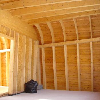 Maison individuelle ossature et charpente bois, courbes, poutres bois