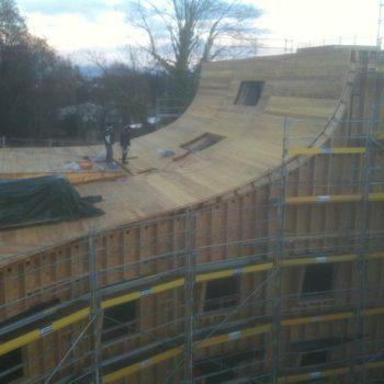 Bâtiment ossature bois courbé