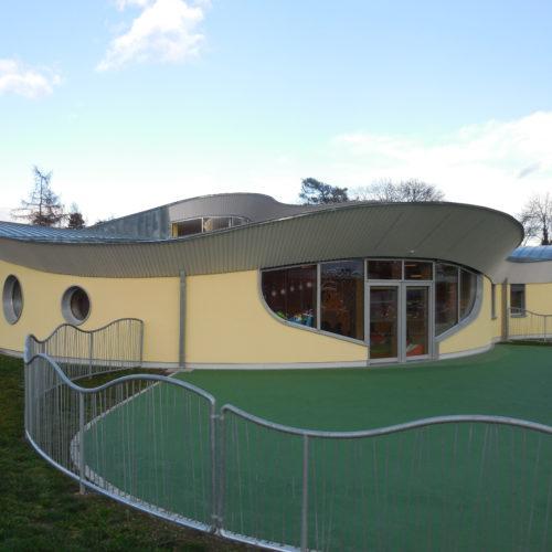 bâtiment scolaire ossature bois revêtement crépi