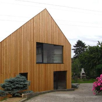 Maison ossature charpente bois, bâtiment basse consommation, bardage bois mélèze