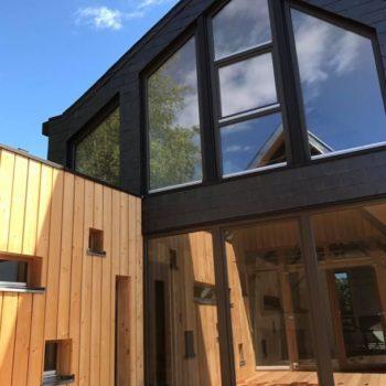 Rénovation et extension en bois d'un logement